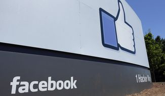 FILE - This July 16, 2013 file photo shows a sign at Facebook headquarters in Menlo Park, Calif. Facebook says hackers accessed data from 29 million accounts as part of the security breach disclosed two weeks ago. (AP Photo/Ben Margot, File)
