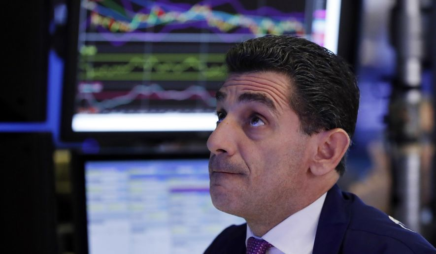 Specialist Peter Mazza works on the floor of the New York Stock Exchange, Thursday, Oct. 11, 2018. Stocks are slumping for a second straight day as the market endures its most volatile stretch since February. (AP Photo/Richard Drew)