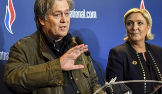 FILE - In this Saturday, March 10, 2018 file photo, former White House strategist Steve Bannon holds a press conference with National Front party leader Marine Le Pen, right, at the party congress in the northern French city of Lille. Far-right French leader Marine Le Pen has met with former White House strategist Steve Bannon and signaled her interest in his project to help European populist parties _ just days after rejecting assistance from an American. (AP Photo, File)