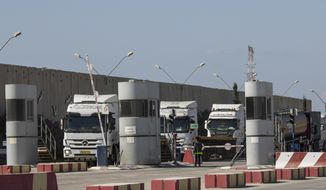 Israeli trucks carrying diesel fuel enteri Kerem Shalom cargo crossing on the Israel Gaza border, Thursday, Oct. 11, 2018. Qatar has agreed to buy fuel to restart the only power plant in the Hamas-ruled Gaza Strip, a top United Nations official said Tuesday, triggering accusations by the Palestinian Authority running the rival government in the West Bank that this will perpetuate the militants' control of the isolated enclave. (AP Photo/Tsafrir Abayov)