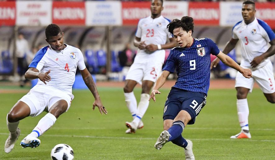 Japan's Takumi Minamino, front right, scores a goal during the first half of their Kirin Challenge Cup soccer match against Panama in Niigata, Niigata prefecture, north of Tokyo Friday, Oct. 12, 2018. (Yu Nakajima/Kyodo News via AP)