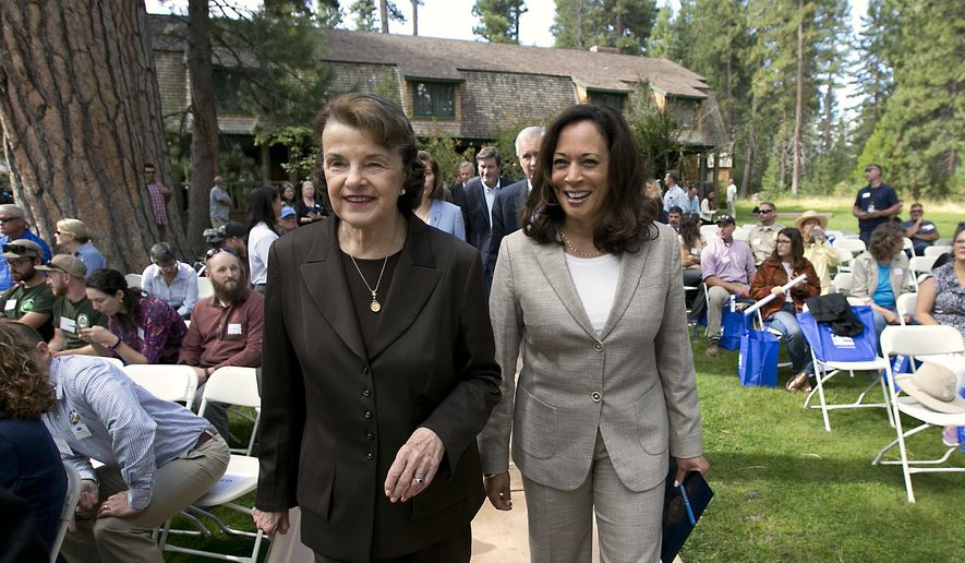 In this Aug. 22, 2017, file photo, California's Democratic U.S. Sens. Dianne Feinstein, left, and Kamala Harris walk together to speak at the 21st Annual Lake Tahoe Summit in South Lake Tahoe, Calif. The senators said they did not sign off on three White House nominees for open California seats on the 9th Circuit Court of Appeals and will oppose their confirmation, according to a report. (AP Photo/Rich Pedroncelli, File)