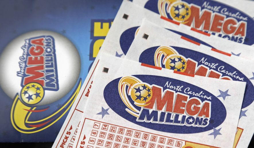 FILE - In this July 1, 2016, file photo, Mega Millions lottery tickets rest on a counter at a Pilot travel center near Burlington, N.C. A lucky player could soon overcome remarkably bad odds to win the ninth-largest lottery jackpot in U.S. history. Numbers will be drawn Friday night, Oct. 12, 2018 for a chance at the estimated $548 million Mega Millions prize. The jackpot has been growing since July, when a group of California office workers won $543 million. (AP Photo/Gerry Broome, File)