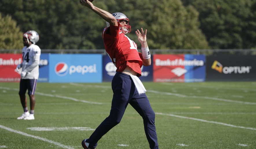 New England Patriots quarterback Tom Brady winds up to throw the ball during NFL football practice, Wednesday, Oct. 10, 2018, in Foxborough, Mass. (AP Photo/Steven Senne)