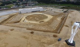 FILE - This Aug. 25, 2018, file photo, shows a general aerial view of the dismantled stadium for the opening and closing ceremonies of the 2018 Pyeongchang Winter Olympics with the Olympic cauldron, right, in Pyeongchang, South Korea. Pyeongchang is already considering razing some of the venues it built for this year's Winter Games because there's simply no use for them, while Tokyo is reportedly set to spend a staggering $25 billion on the next Summer Games. (Yang Ji-woong/Yonhap via AP, File)