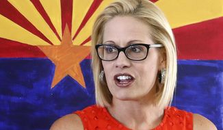 FILE--In this Aug. 28, 2018, file photo, Rep. Kyrsten Sinema, D-Ariz., talks to campaign volunteers at a Democratic campaign office on primary election day in Phoenix. Sinema is in a tight race with Republican Martha McSally. Both congresswomen are vacating their positions to run for Sen. Jeff Flake's seat. (AP Photo/Ross D. Franklin, file)