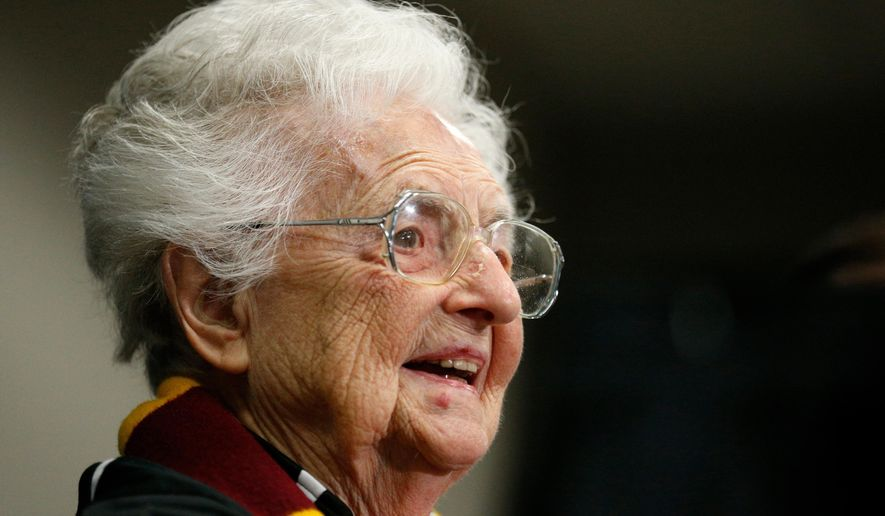 FILE - In this March 30, 2018, file photo, Loyola's Sister Jean Dolores Schmidt answers questions during a news conference for the Final Four NCAA college basketball tournament in San Antonio. Sister Jean is the winner of Illinois' 2018 Senior Hall of Fame award. The Catholic nun and longtime chaplain of the Loyola-Chicago basketball team became a celebrity last March as the Ramblers reached the NCAA Final Four. In August she celebrated her 99th birthday. (AP Photo/Brynn Anderson, File)