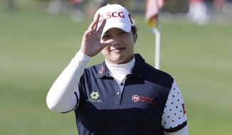 Ariya Jutanugarn of Thailand gestures on the 18th hole after finishing the second round of the LPGA KEB Hana Bank Championship at Sky72 Golf Club in Incheon, South Korea, Friday, Oct. 12, 2018. (AP Photo/Lee Jin-man)