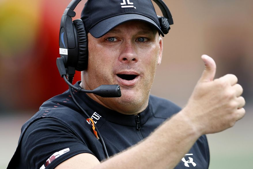 FILE - In this Saturday, Sept. 15, 2018, file photo, Temple head coach Geoff Collins gestures in the second half of an NCAA college football game against Maryland in College Park, Md. Temple is unbeaten in the American Athletic Conference, and intends to stay that way after facing skidding Navy on Saturday. (AP Photo/Patrick Semansky, File)