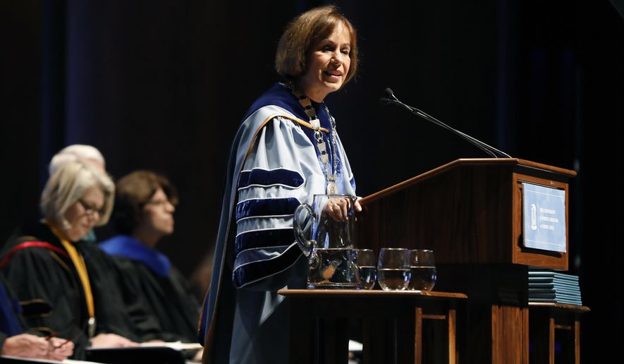 UNC Chapel Hill Chancellor Carol Folt speaks during University Day at Memorial Hall, Friday, Oct. 12, 2018 in Chapel Hill, N.C. Folt apologized Friday for the school's history of slavery, adding that words alone are not enough to atone for using enslaved people to build and maintain the campus. (Ethan Hyman/The News & Observer via AP)