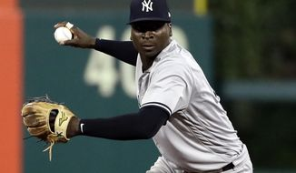 FILE - In this June 26, 2018, file photo, New York Yankees shortstop Didi Gregorius prepares to throw to first after fielding a ball during a baseball game against the Philadelphia Phillies in Philadelphia. The Yankees say star shortstop will need Tommy John surgery on his right elbow after injuring himself during the AL Division Series, the team announced Friday, Oct. 12, 2018.  (AP Photo/Matt Slocum, File)