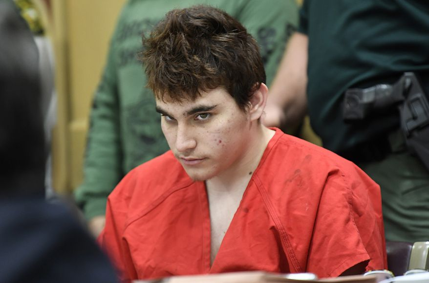 In this April 27, 2018, file photo, Florida school shooting suspect Nikolas Cruz looks up while in court for a hearing in Fort Lauderdale, Fla. Records released by prosecutors reveal that Cruz trespassed on school grounds about six months before the massacre that left 17 dead. (Taimy Alvarez/South Florida Sun-Sentinel via AP, Pool, File)