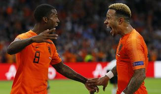 Netherland's scorer Georginio Wijnaldum, left, celebrates after he scored his side's third goal with Netherland's second scorer Memphis Depay, right, during the UEFA Nations League soccer match between The Netherlands and Germany at the Johan Cruyff ArenA in Amsterdam, Saturday, Oct. 13, 2018. The Netherlands defeated Germany with 3-0. (AP Photo/Peter Dejong)