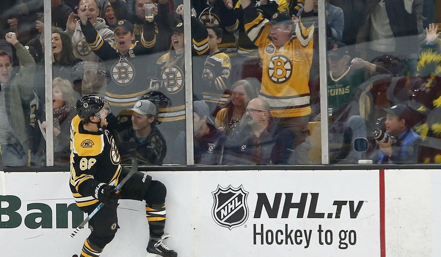 Boston Bruins right wing David Pastrnak (88) reacts after scoring during the first period of an NHL hockey game against the Detroit Red Wings, Saturday, Oct. 13, 2018, in Boston. (AP Photo/Mary Schwalm)