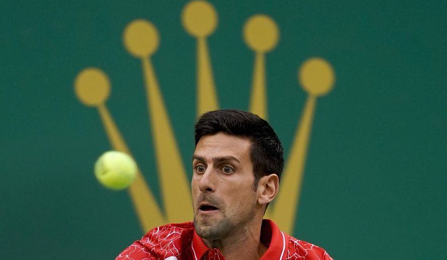 Novak Djokovic of Serbia eyes on the ball as he plays against Alexander Zverev of Germany during their men's singles semifinals match in the Shanghai Masters tennis tournament at Qizhong Forest Sports City Tennis Center in Shanghai, China, Saturday, Oct. 13, 2018. (AP Photo/Andy Wong)