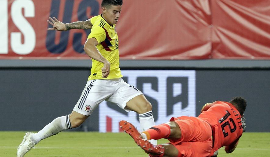 U.S. goalkeeper Zack Steffen (12) blocks a shot by Colombia's James Rodriguez, left, during the first half of an international friendly soccer match Thursday, Oct. 11, 2018, in Tampa, Fla. (AP Photo/John Raoux)
