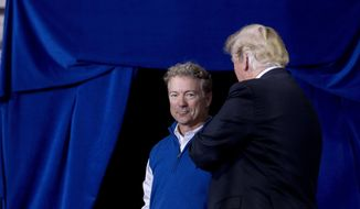 Sen. Rand Paul, R-Ky., is brought up on stage by President Donald Trump as he takes the stage at a rally at Alumni Coliseum in Richmond, Ky., Saturday, Oct. 13, 2018. (AP Photo/Andrew Harnik)