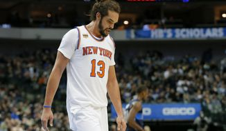 FILE - In this Jan. 25, 2017, file photo, New York Knicks' Joakim Noah (13) walks to the bench during a time out in the second half of an NBA basketball game against the Dallas Mavericks in Dallas. Noah's disappointing Knicks career is over after just two seasons. Unable to find a trade, the Knicks waived the center Saturday, Oct. 13, 2018, with two years and $37.8 million remaining on his contract. (AP Photo/Tony Gutierrez, File)