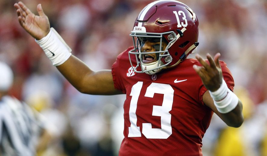 Alabama quarterback Tua Tagovailoa (13) gestures after throwing a touchdown pass during the first half against Missouri in an NCAA college football game Saturday, Oct. 13, 2018, in Tuscaloosa, Ala. (AP Photo/Butch Dill)
