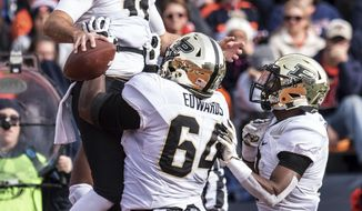 Purdue quarterback David Blough celebrates his touchdown catch with teammates in the first half of an NCAA college football game, Saturday, Oct. 13, 2018, in Champaign, Ill. (AP Photo/Holly Hart)