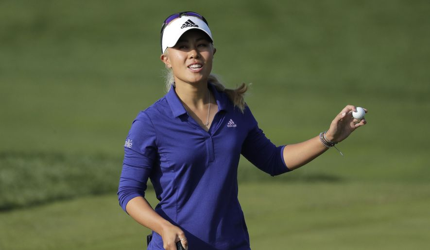 Danielle Kang of the United States reacts on the 18th hole after finishing the third round of the LPGA KEB Hana Bank Championship at Sky72 Golf Club in Incheon, South Korea, Saturday, Oct. 13, 2018. (AP Photo/Lee Jin-man)