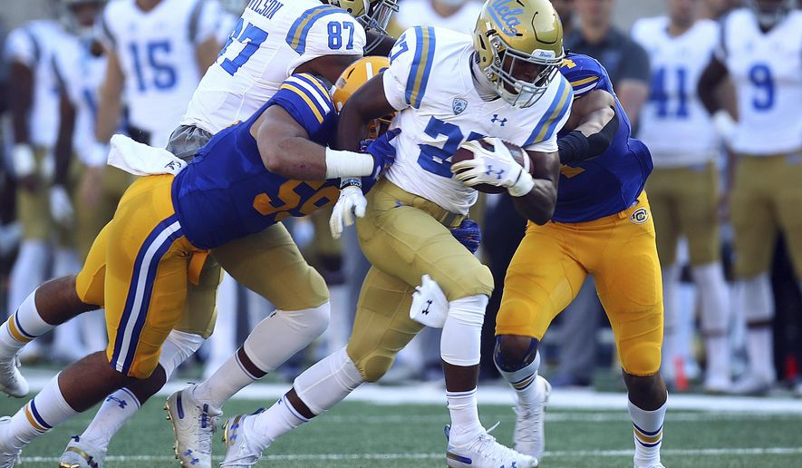 UCLA's Joshua Kelley (27) rushes against California during the first half of an NCAA college football game Saturday, Oct. 13, 2018, in Berkeley, Calif. (AP Photo/Ben Margot)