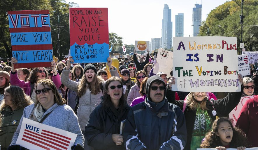 Thousands rally in Grant Park before the start of the Women's March Chicago on Saturday, Oct. 13, 2018 in Chicago.   Thousands of people marched through downtown Chicago to express their displeasure at President Donald Trump and encourage voters to go to the polls for next month's midterm election.  (Ashlee Rezin/Chicago Sun-Times via AP) **FILE**