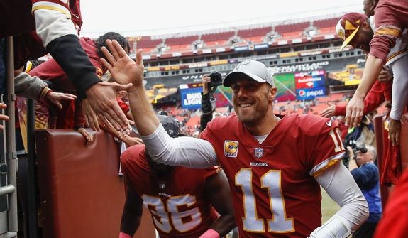 Redskins quarterback Alex Smith staked Washington to a two-touchdown lead in the first quarter and finished 21-for-36 passing for 163 yards in Sunday's victory over the Carolina Panthers. (Associated Press)