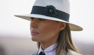 First lady Melania Trump pauses as she speaks to media during a visit to the historical Giza Pyramids site near Cairo, Egypt on Saturday, Oct. 6, 2018. Trump is visiting Africa on her first big solo international trip. (AP Photo/Carolyn Kaster)