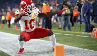 Kansas City Chiefs wide receiver Tyreek Hill strikes a pose as he warms up before an NFL football game, Sunday against the New England Patriots, Oct. 14, 2018, in Foxborough, Mass. (AP Photo/Michael Dwyer) ** FILE **