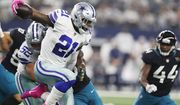 Dallas Cowboys running back Ezekiel Elliott (21) battles past the Jacksonville Jaguars defense in the second half of an NFL football game in Arlington, Texas, Sunday, Oct. 14, 2018. (AP Photo/Jim Cowsert)