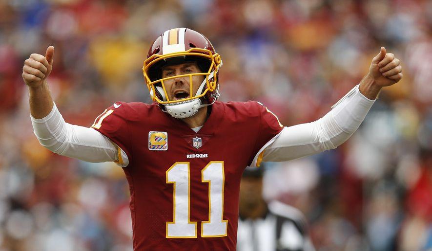 Washington Redskins quarterback Alex Smith (11) signals the line during the first half of an NFL football game between the Washington Redskins and the Carolina Panthers, Sunday, Oct. 14, 2018 in Landover, Md. (AP Photo/Patrick Semansky)
