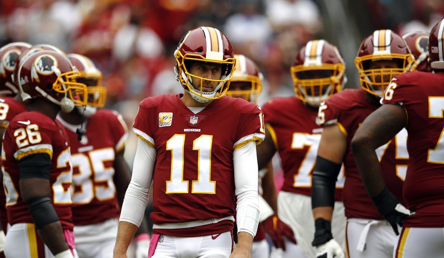 1c136241818 Washington Redskins quarterback Alex Smith waits to huddle with teammates  during an NFL football game against