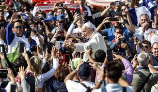 "Pope Francis waves to faithful as he leaves St. Peter's Square at the Vatican, Sunday, Oct. 14, 2018. Pope Francis has declared Pope Paul VI and slain Salvadoran Archbishop Oscar Romero saints, reciting in Latin the rite of canonization at the start of Mass in St. Peter's Square. After hearing brief biographies of Paul, Romero and five other people canonized Sunday, Francis declared them saints and ""decreed that they are to be venerated as such by the whole church."" (Giuseppe Lami/ANSA via AP)"