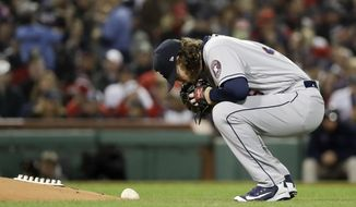 Houston Astros starting pitcher Gerrit Cole prepares to pitch against the Boston Red Sox during the first inning in Game 2 of a baseball American League Championship Series on Sunday, Oct. 14, 2018, in Boston. (AP Photo/David J. Phillip)