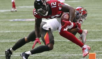 Atlanta Falcons wide receiver Mohamed Sanu (12) dives into the end zone past Tampa Bay Buccaneers safety Justin Evans during the first quarter of an NFL football game Sunday, Oct 14, 2018, in Atlanta. (Curtis Compton/Atlanta Journal-Constitution via AP)
