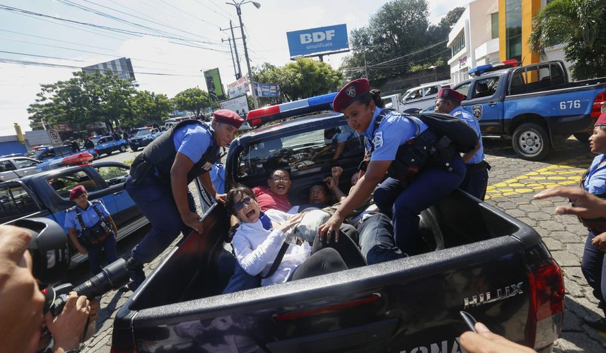 """Anti-government protesters are arrested and taken away by police as the security forces disrupt their march, coined """"United for Freedom,"""" in Managua, Nicaragua, Sunday, Oct. 14, 2018. Anti-government protests calling for President Daniel Ortega's resignation are ongoing since April, triggered by a since-rescinded government plan to cut social security pensions. Ortega said opponents will have to wait until his term ends in 2021. (AP Photo/Alfredo Zuniga)"""