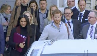 In this image made from video, Britain's Prince Harry, center right, and his wife Meghan Markle, left, Duke and Duchess of Sussex, approach a car at an airport in Sydney, Monday, Oct. 15, 2018. Prince Harry and his wife Meghan arrived in Sydney on Monday, a day before they officially start a 16-day tour of Australia and the South Pacific.(Australian Pool via AP)