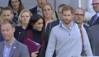 In this image made from video, Britain's Prince Harry, center right, and his wife Meghan, center left, Duke and Duchess of Sussex, approach a car at an airport in Sydney, Monday, Oct. 15, 2018. Prince Harry and his wife Meghan arrived in Sydney on Monday, a day before they officially start a 16-day tour of Australia and the South Pacific.(Australian Pool via AP)