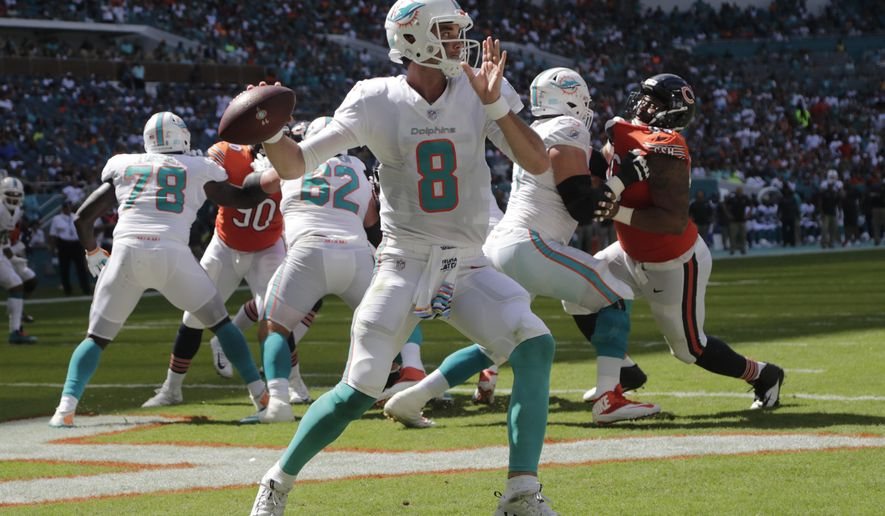 Miami Dolphins quarterback Brock Osweiler (8) looks to pass during the first half of an NFL football game against the Chicago Bears, Sunday, Oct. 14, 2018, in Miami Gardens, Fla. (AP Photo/Lynne Sladky)