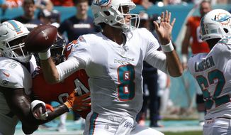 Miami Dolphins quarterback Brock Osweiler (8) looks to pass, during the first half of an NFL football game against the Chicago Bears, Sunday, Oct. 14, 2018, in Miami Gardens, Fla. (AP Photo/Joel Auerbach)