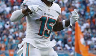 Miami Dolphins wide receiver Albert Wilson (15) celebrates after scoring a touchdown, during the second half of an NFL football game against the Chicago Bears, Sunday, Oct. 14, 2018, in Miami Gardens, Fla. (AP Photo/Joel Auerbach)