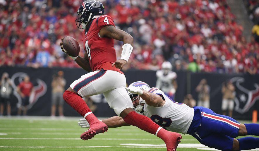 Houston Texans quarterback Deshaun Watson (4) runs from Buffalo Bills linebacker Matt Milano (58) during the first half of an NFL football game, Sunday, Oct. 14, 2018, in Houston. (AP Photo/Eric Christian Smith)