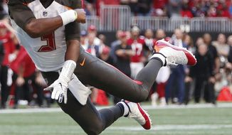 Tampa Bay Buccaneers quarterback Jameis Winston (3) tosses the ball against the Atlanta Falcons during the second half of an NFL football game, Sunday, Oct. 14, 2018, in Atlanta. The Atlanta Falcons won 34-29. (AP Photo/John Bazemore)
