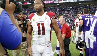 Arizona Cardinals wide receiver Larry Fitzgerald walks off the field after an NFL football game against the Minnesota Vikings, Sunday, Oct. 14, 2018, in Minneapolis. The Vikings won 27-17. (AP Photo/Bruce Kluckhohn)