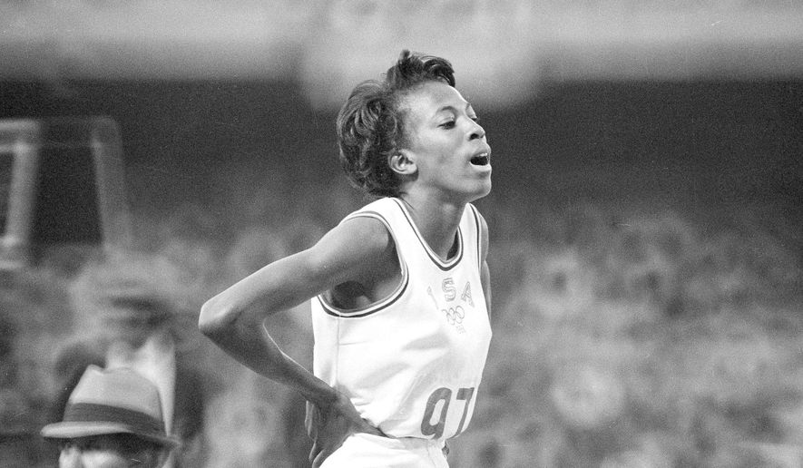 FILE - In this Oct. 19, 1968, file photo, United States' Madeline Manning catches her breath after winning the women's 800-meter run in record time of 2:00.9, at the Olympics in Mexico City. Fifty years ago, Madeline Manning Mims became the first black woman to win the Olympic 800 meters. Her story got overshadowed at the 1968 Mexico City Games by Tommie Smith and John Carlos, who raised black-gloved fists on the medal stand during the national anthem to protest America's social injustices. (AP Photo/File)