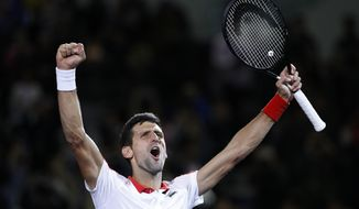 Novak Djokovic of Serbia celebrates after defeating Borna Coric of Croatia in their men's singles final match in the Shanghai Masters tennis tournament at Qizhong Forest Sports City Tennis Center in Shanghai, China, Sunday, Oct. 14, 2018. (AP Photo/Andy Wong)