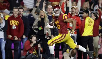 Southern California wide receiver Michael Pittman Jr. (6) runs for a touchdown after a reception during the first half of an NCAA college football game against Colorado on Saturday, Oct. 13, 2018, in Los Angeles. (AP Photo/Marcio Jose Sanchez)