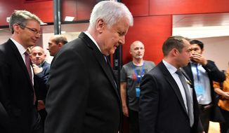 Horst Seehofer, German Interior Minister and Chairman of the Christian Social Union, CSU, arrives for a statement in the state parliament in Munich, Germany, Sunday, Oct. 14, 2018, after his party lost in he Bavarian state election. (AP Photo/Kerstin Joensson)