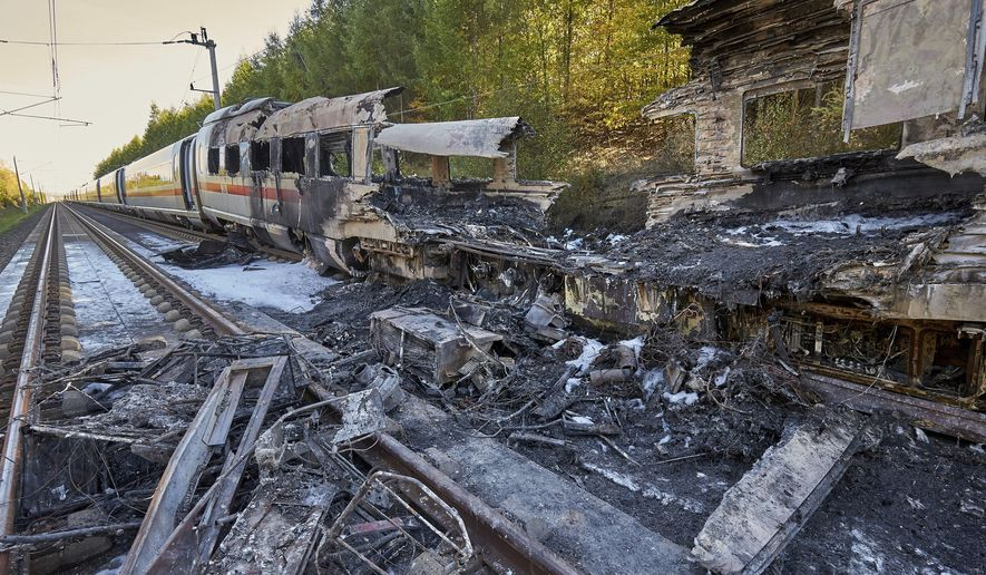 Remnants of a train lay on the tracks after an ICE high-speed train caught fire in Dierdorf near Montabaur, western Germany, Friday, Oct. 12, 2018. Nobody was injured in the fire that broke out for unknown reasons. (Thomas Frey/dpa via AP)